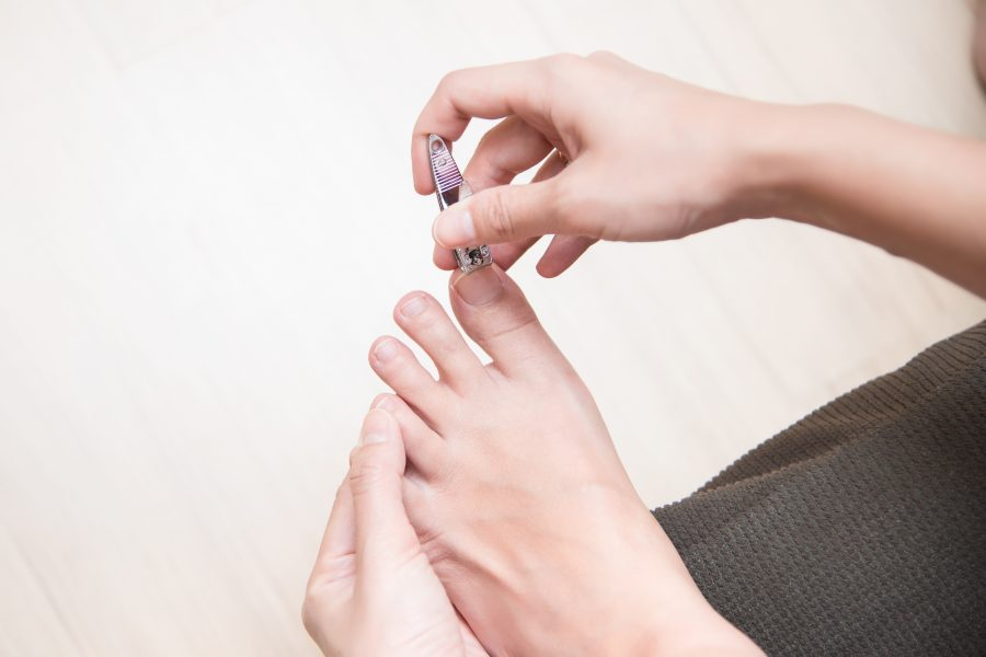 How do we treat an ingrown toenail at home?